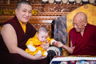 His Eminence Luding Khenchen Rinpoche and little Thugsey share a moment