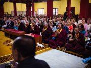Students pray at KIBI earlier this year