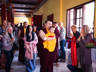 Sangyumla and students smile as Karmapa walks Thugsey through KIBI on the last day of the Karmapa Public Course 2019