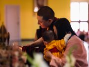 A light of hope: Karmapa, Sangyumla and Thugsey light the butter lamp at the altar at KIBI