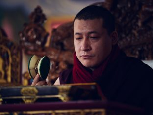 Thaye Dorje, His Holiness the 17th Gyalwa Karmapa, presides over a fire puja at His Eminence Beru Khyentse Rinpoche's guest house, India, December 2019. Photo / Tokpa Korlo