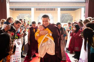 Thaye Dorje, His Holiness the 17th Gyalwa Karmapa, brings his son Thugsey with him to the Public Meditation Course at KIBI. His wife, Sangyumla Rinchen Yangzom, follows closely behind