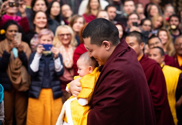 Thaye Dorje, His Holiness the 17th Gyalwa Karmapa, shares a tender moment with his son Thugsey at KIBI