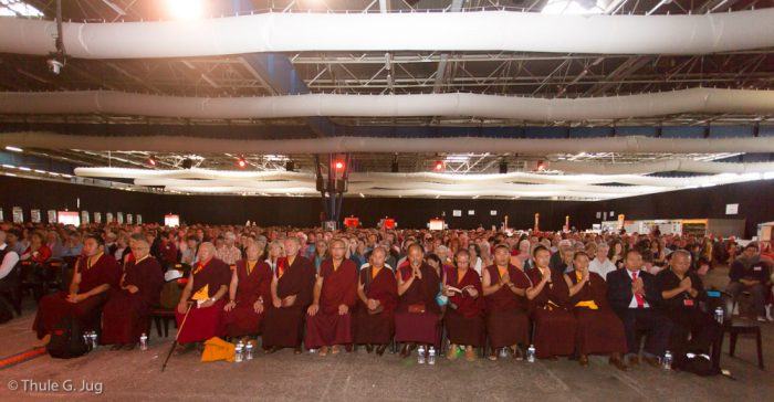 The monks among a sea of people at the Alpexpo convention centre in Grenoble