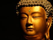 The head of a statue of the Buddha, illustrating a quote about mindfulness