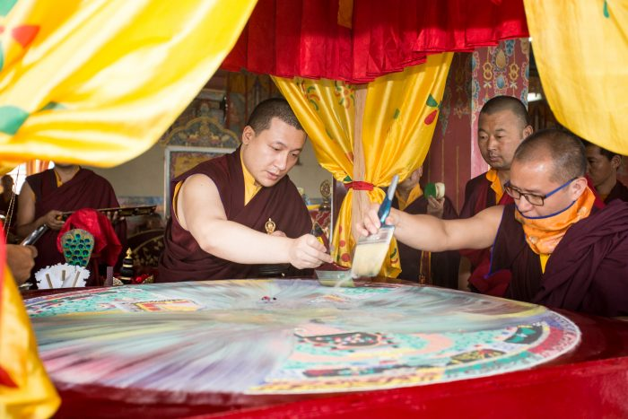 Thaye Dorje, His Holiness the 17th Gyalwa Karmapa, dissolving the sand mandala on the final day of the Gyalwa Gyamtso puja. Photo / Magda Jungoska
