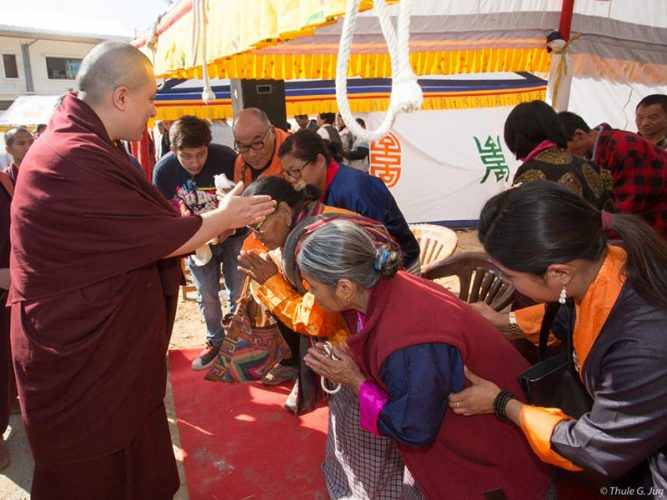 Devotees being blessed by Thaye Dorje, His Holiness the 17th Gyalwa Karmapa. Photo / Thule Jug