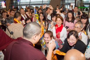 Thaye Dorje, His Holiness the 17th Gyalwa Karmapa, greets devotees in Taipei International Airport. Photo / Thule Jug