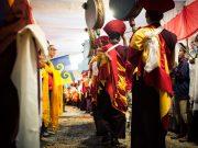 Student of His Holiness Karmapa Thaye Dorje with the Karmapa Dream Flag