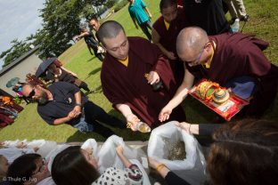 Thaye Dorje, His Holiness the 17th Gyalwa Karmapa, blessing fish before releasing them into the river