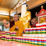 Thaye Dorje, His Holiness the 17th Gyalwa Karmapa, blessing mantra rolls in France 2015. Photo / Thule Jug