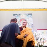 Thaye Dorje, His Holiness the 17th Gyalwa Karmapa, blessing students. Assisting is Tsultrim Namgyal, attendant to the 16th Karmapa. Photo / Tokpa Korlo
