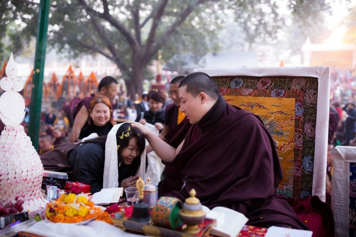 Thaye Dorje, His Holiness the 17th Gyalwa Karmapa, blessing a devotee at the Kagyu Monlam 2014. Photo / Tokpa Korlo