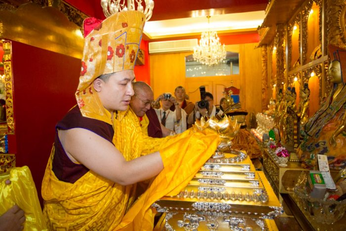 Thaye Dorje, His Holiness the 17th Gyalwa Karmapa, puts the relics of Shamar Rinpoche inside the stupa. Photo / Thule Jug