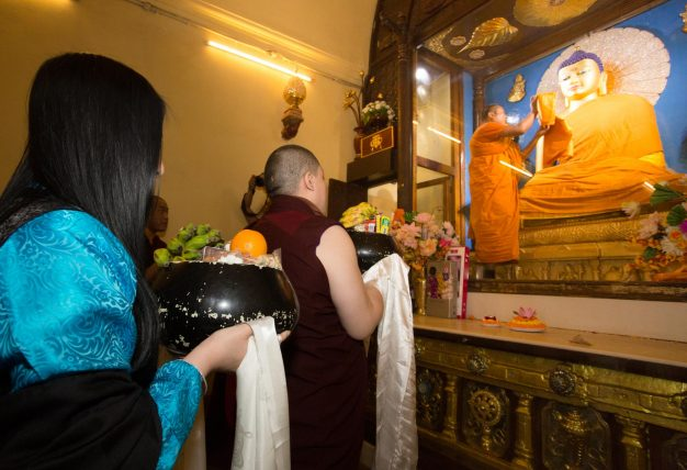 Thaye Dorje, His Holiness the 17th Gyalwa Karmapa, and his wife Sangyumla offering prayers at Bodh Gaya in 2017