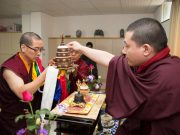 Lama Puntsok offers a mandala to Thaye Dorje, His Holiness the 17th Gyalwa Karmapa. Photo / Thule Jug