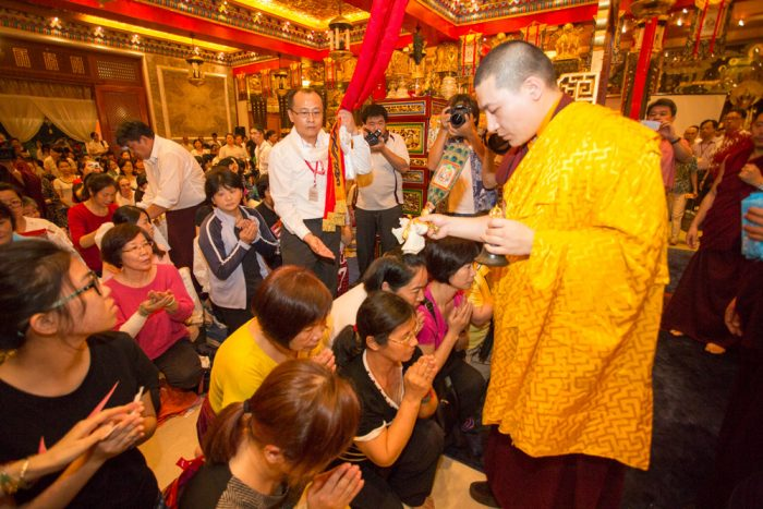 Thaye Dorje, His Holiness the 17th Gyalwa Karmapa, blessing devotees. Photo / Thule Jug