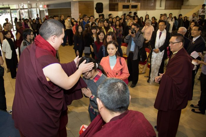 Thaye Dorje, His Holiness the 17th Gyalwa Karmapa, blessing members of the public in Changhua, Taiwan. Photo / Thule Jug