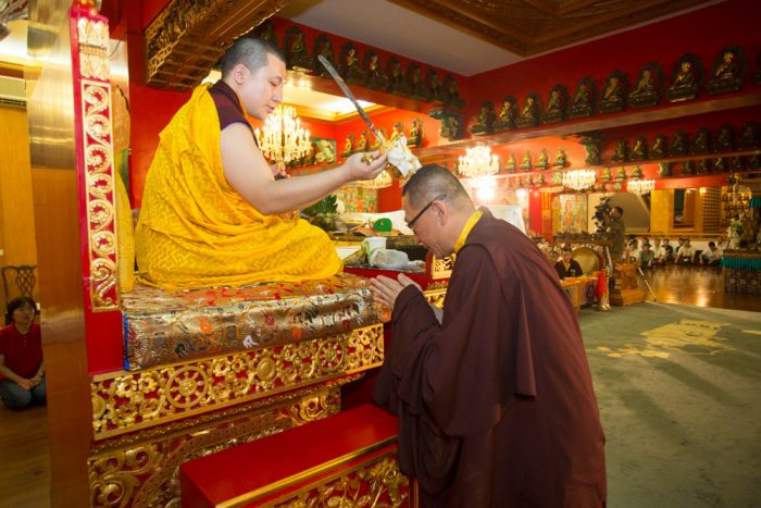 Thaye Dorje, His Holiness the 17th Gyalwa Karmapa, blessing Lopon Rinpoche during the empowerment. Photo / Thule Jug