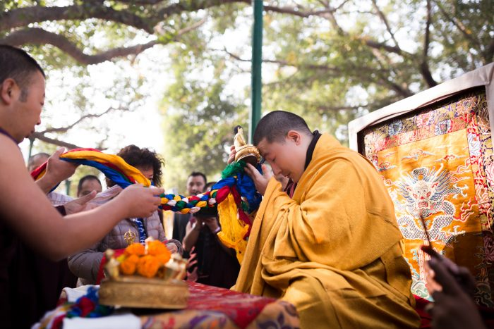 Thaye Dorje, His Holiness the 17th Gyalwa Karmapa, blessing ritual objects at the Kagyu Monlam 2014. Photo / Tokpa Korlo