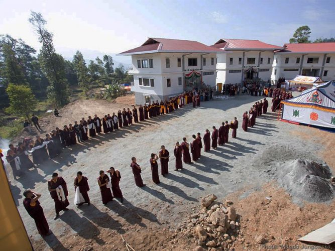 Monks waiting for Thaye Dorje, His Holiness the 17th Gyalwa Karmapa, at the Karmapa Center for Education. Photo / Magda Jungowska