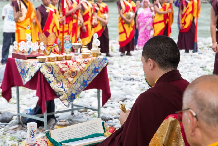 Preparing the mandala offering to be poured into the river on the 3rd anniversary of the parinirvana of His Holiness Kunzig Shamar Rinpoche. Photo / Magda Jungowska