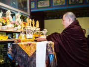 Tribute to Shamar Rinpoche: Thaye Dorje, His Holiness the 17th Gyalwa Karmapa, places Shamar Rinpoche's relics on the main altar. Photo / Tokpa Korlo