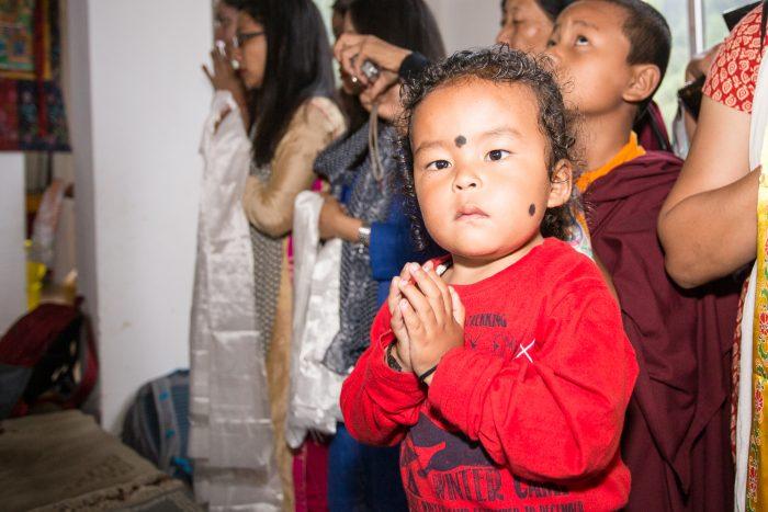Children welcome Thaye Dorje, His Holiness the 17th Gyalwa Karmapa, to Thagda Diwakar Buddhist School. Photo / Magda Jungowska